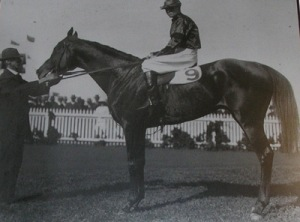 George Jones with a racehorse and jockey.